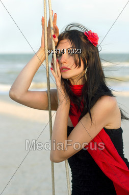 Portrait Of Sexy Young Woman Sitting On A Swing Stock Photo