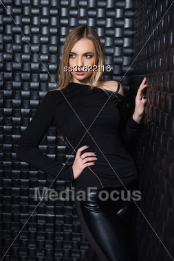 Portrait Of Sexy Young Woman Wearing Black Clothes Posing In Studio Stock Photo