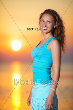 Portrait Of Smiling Blond Woman Posing At The Sunset Stock Photo