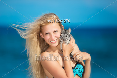 Portrait Of Smiling Blonde Posing With Chinchilla Stock Photo