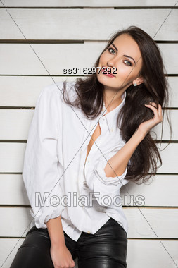 Portrait Of Smiling Brunette Wearing White Shirt Stock Photo