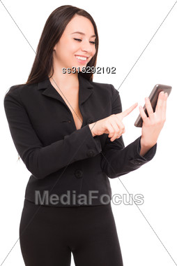 Portrait Of Smiling Businesswoman With Smartphone. Isolated On White Stock Photo