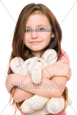 Portrait Of Smiling Little Girl With A Teddy Elephant. Stock Photo