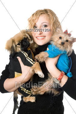 Portrait Of Smiling Pretty Blonde With Two Dogs. Stock Photo