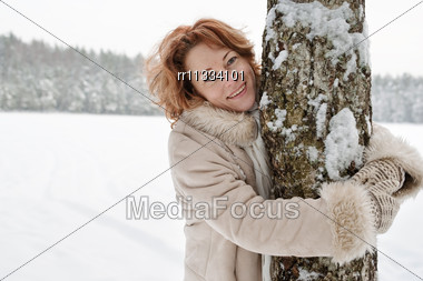 Portrait Of Smiling Red-haired Woman In Winters Day. Stock Photo