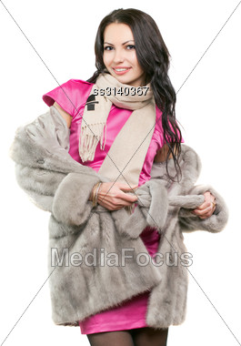 Portrait Of Smiling Young Brunette In A Fur Coat. Isolated Stock Photo