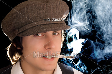 Portrait Of Smoking Man With Cunning Smile. Stock Photo