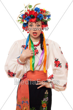 Portrait Of Surprised Young Woman In The Ukrainian National Clothes Stock Photo