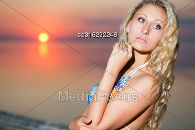 Portrait Of Thoughtful Blond Woman At The Sunset Stock Photo