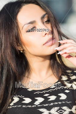 Portrait Of Thoughtful Brunette Posing Posing Outdoors Stock Photo