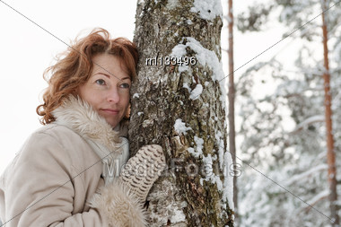 Portrait Of Thoughtful Red-haired Woman In Winters Day Stock Photo