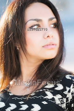Portrait Of Thoughtful Young Brunette With Brown Eyes Stock Photo