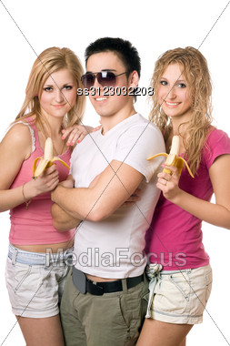 Portrait Of Three Cheerful Beautiful Young People Stock Photo