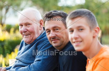 Portrait Of Three Generations Male Family Members Together Stock Photo