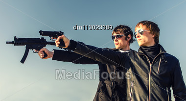 Portrait Of Two Tough Guys With Guns Stock Photo