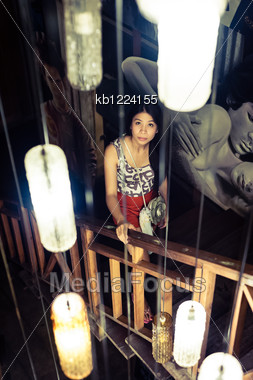Portrait Woman At Stair With Lamp Light Stock Photo