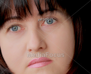 Portrait Of Woman With Blue Eyes And Black Hair Stock Photo
