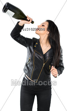 Portrait Of Woman Posing In Black Jacket With A Bottle. Isolated On White Stock Photo