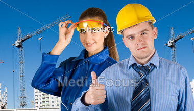 Portrait Of Young Architects At In Front Of Construction Site, Building And Crane. Stock Photo