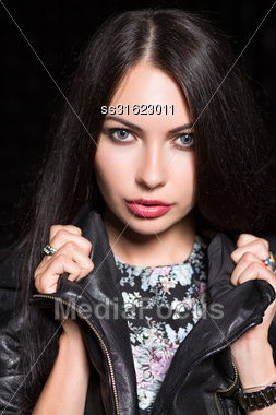 Portrait Of Young Attractive Woman Posing In Black Leather Jacket. Isolated Stock Photo
