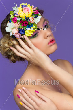 Portrait Of Young Beautiful Blond Girl Wearing Flower Headband Over Purple Background Stock Photo