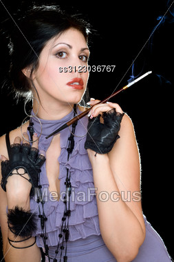 Portrait Of A Young Beautiful Brunette With Cigarette Holder Stock Photo