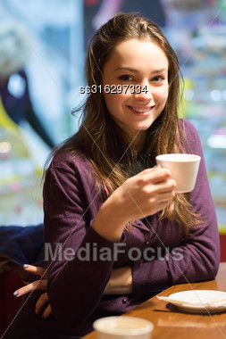 Portrait Of Young Beautiful Brunette Posing In The Cafe Stock Photo