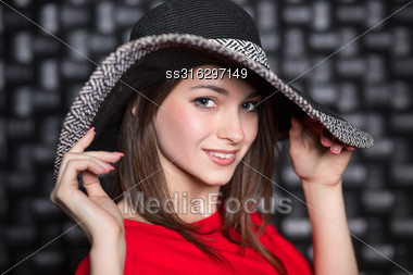 Portrait Of Young Beautiful Woman Posing In Hat Stock Photo