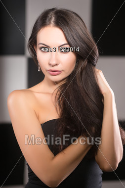 Portrait Of Young Beautiful Woman Posing In The Studio Stock Photo