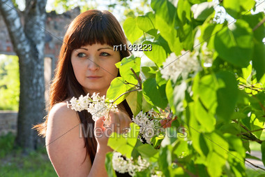 Portrait Of Young Beautiful Woman With Pipe-tree Stock Photo