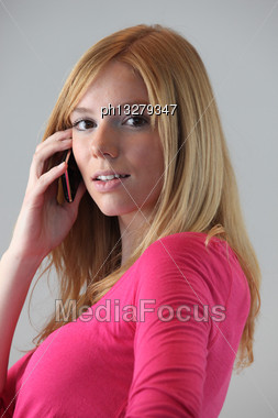 Portrait Of Young Blond Woman With Mobile Phone Stock Photo