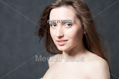Portrait Of A Young Brunette Lady Stock Photo