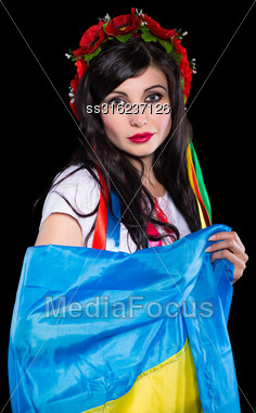 Portrait Of Young Brunette Posing With Ukrainian Flag. Isolated On Black Stock Photo