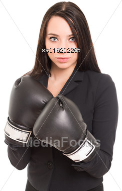 Portrait Of Young Brunette Wearing Black Boxing Gloves. Isolated On White Stock Photo