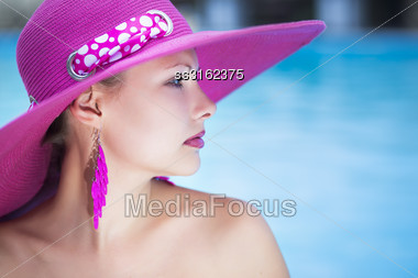 Portrait Of Young Caucasian Thoughtful Lady Posing In Pink Hat Stock Photo