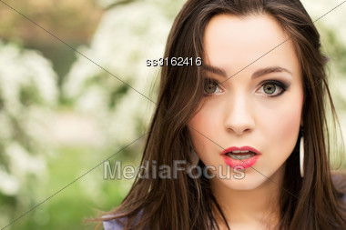Portrait Of Young Pretty Brunette With Surprised Face Stock Photo