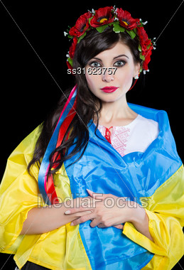 Portrait Of Young Pretty Ukrainian Woman Posing With Flag. Isolated On Black Stock Photo