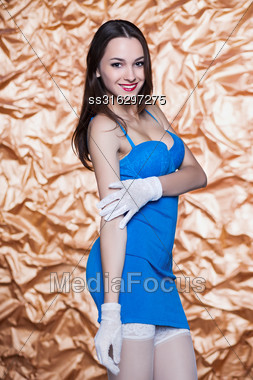 Portrait Of Young Sexy Woman Posing In Blue Dress And White Gloves Stock Photo