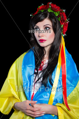 Portrait Of Young Thoughtful Ukrainian Woman Posing With A Flag. Isolated On Black Stock Photo