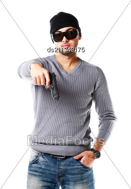 Portrait Of Young Trendy African Man Posing With Handgun Stock Photo