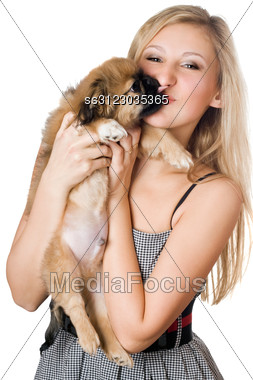 Portrait Of Young Woman Kissing Her Puppy. Stock Photo