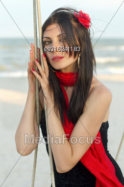 Portrait Of Young Woman Sitting On A Swing Stock Photo