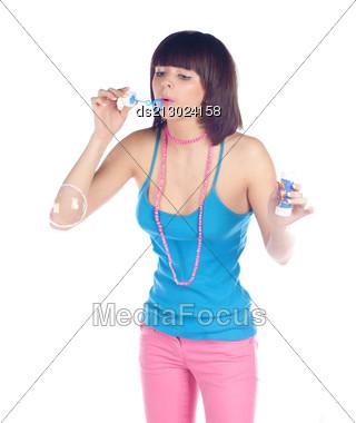 Portrait Of A Young Women Blowing Soap Bubbles Torso Shot On White Stock Photo