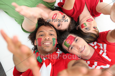 Portuguese Football Fans Reaching Out Stock Photo