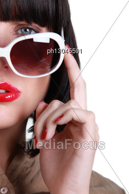 Posing Woman With Sunglasses Stock Photo