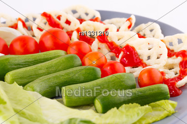 Potato Chips And Vegetables On Plate Stock Photo