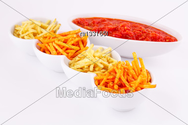 Potato Chips And Red Sauce Isolated On Gray Background Stock Photo