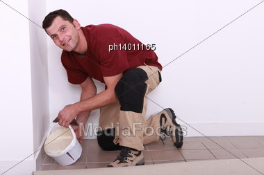 Pouring Floor Tiler Product Stock Photo