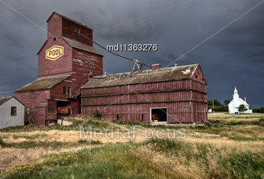 Prairie Grain Elevator And Church Saskatchewan Canada Stock Photo