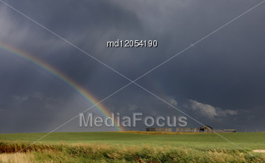 Prairie Hail Storm And Rainbow In Saskatchewan Canada Stock Photo